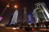 """08 APR 2013, DOHA/QATAR<br /> Doha Tower, auch """"Condom Tower"""", Tornado Tower, All Jassimya Tower und Salam Tower (v.L.n.R.), gesehen von der Al Corniche Street<br /> IMAGE: 20130408-01-035<br /> KEYWORDS: Katar, Hochaus, Wolkenkratzer, Tower, Skyscraper, Skyline, Nacht, night, Nachtaufnahme, Hochhaeuser, Hochäuser, Skyscraper, Skyscraper, West Bay, Dwontown Doha"""