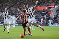 Shane Long of Southampton under pressure from Gareth McAuley of West Bromwich Albion - Mandatory by-line: Jason Brown/JMP - 07966386802 - 16/01/2016 - FOOTBALL - Southampton, St Mary's Stadium - Southampton v West Bromwich Albion - Barclays Premier League