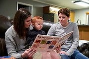 Katie Tavey and Emily Nicks read a book with their son Luka Tavey-Nicks at their home in Kilgore, Texas on January 7, 2018. (Cooper Neill for Buzzfeed News)
