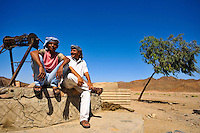 Local members of our support crew rest by a well in the middle of the Eastern Desert