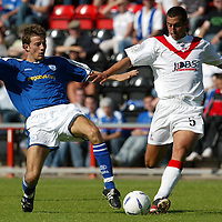 Airdrie v St Johnstone...07.08.04<br />Lee Hardy tackles Alan McManus<br /><br />Picture by Graeme Hart.<br />Copyright Perthshire Picture Agency<br />Tel: 01738 623350  Mobile: 07990 594431