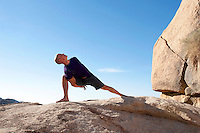 Man in yoga pose bound lunge outdoors in a spectatcular stone landscape.<br /> :::<br /> tapasvibhyo 'dhiko yogi <br /> jnanibhyo 'pi mato 'dhikah <br /> karmibhyas cadhiko yogi <br /> tasmad yogi bhavarjuna<br /> <br /> &quot;A yogi is greater than the ascetic, greater than the empiricist and greater than the fruitive worker. Therefore, O Arjuna, in all circumstances, be a yogi.&quot;<br /> -Bhagavad Gita