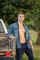 hot guy with open shirt by an old truck
