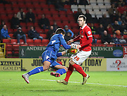 Leeds United goalkeeper Marco Silvestri save before Charlton Athletic defender Harry Lennon could pounce during the Sky Bet Championship match between Charlton Athletic and Leeds United at The Valley, London, England on 12 December 2015. Photo by Matthew Redman.