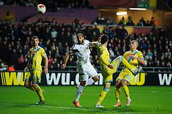 Swansea Defender Ashley Williams (WAL) heads wide - Photo mandatory by-line: Rogan Thomson/JMP - Tel: 07966 386802 - 20/02/2014 - SPORT - FOOTBALL - Liberty Stadium, Swansea -  Swansea City v SSC Napoli - UEFA Europa League, Round of 32, First Leg.