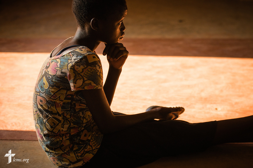 A young girl listens during worship at a Confessional Lutheran Church–Malawi Synod parish on Saturday, Sept. 26, in Embangweni, Malawi. LCMS Communications/Erik M. Lunsford