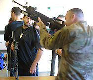 Marc Zamarin (left) of Philadelphia, Pennsylvania looks on as SSG Jack Boeker shows how to handle a rifle during an Honorary Commander boot camp for 40 local officials Thursday October 29, 2015 at Joint Base McGuire-Dix-Lakehurst  in Fort Dix, New Jersey. Participants experienced combined arms training, simulated combat environments and enjoyed a military cuisine. (Photo by William Thomas Cain)