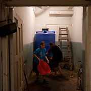 DONETSK, UKRAINE - OCTOBER 16, 2014: IDPs collect water at a Soviet era bomb shelter in Petrovskiy district, Donetsk. The around hundred people living here from almost four months, complain of the lack of conditions at the bunker and fear now the serious difficulties they will be exposed to during the severe winter on the way. CREDIT: Paulo Nunes dos Santos