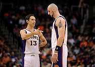Mar. 14, 2012; Phoenix, AZ, USA; Phoenix Suns guard Steve Nash (13) talks with teammate center Marcin Gortat (4) while playing against the Utah Jazz during the first half at the US Airways Center. The Suns defeated the Jazz 120-111. Mandatory Credit: Jennifer Stewart-US PRESSWIRE..