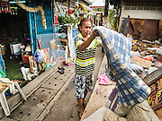 12 NOVEMBER 2015 - BANGKOK, THAILAND:   Residents of the  Wat Kalayanmit neighborhood pack their belongings on the day they were being evicted. Fifty-four homes around Wat Kalayanamit, a historic Buddhist temple on the Chao Phraya River in the Thonburi section of Bangkok, are being razed and the residents evicted to make way for new development at the temple. The abbot of the temple said he was evicting the residents, who have lived on the temple grounds for generations, because their homes are unsafe and because he wants to improve the temple grounds. The evictions are a part of a Bangkok trend, especially along the Chao Phraya River and BTS light rail lines. Low income people are being evicted from their long time homes to make way for urban renewal.       PHOTO BY JACK KURTZ