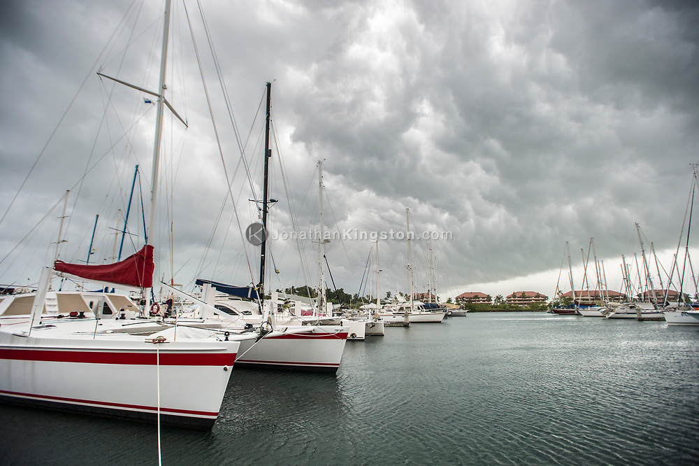 A storm front rolls over sailboats in a marina in Panama.