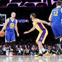 11 April 2014: Los Angeles Lakers guard Kendall Marshall (12) defends on Golden State Warriors guard Stephen Curry (30) during the Golden State Warriors 112-95 victory over the Los Angeles Lakers at the Staples Center, Los Angeles, California, USA.
