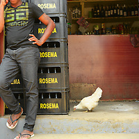 Selling Rosema, the ubiquitous beer at São Tomé.
