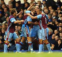 Photo: Paul Greenwood.<br />Everton v Aston Villa. The Barclays Premiership. 11/11/2006. Villa players mob goal scorer Chris Sutton