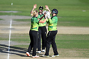 Heather Knight, Rachel Priest and Claire Nicholas of Western Storm celebrate the wicket of Amanda-Jade Wellington during the Kia Women's Cricket Super League Final match between Western Storm and Southern Vipers at the 1st Central County Ground, Hove, United Kingdom on 1 September 2019.