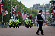 On US President Donald Trump's first day of a controversial three-day state visit to the UK by the 45th American President, British Met Police officers secure the Mall, on 3rd June 2019, in London England.