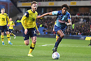 Wycombe Wanderers defender Sido Jambati (2) battles for possession  with Oxford United midfielder James Henry (17) during the EFL Sky Bet League 1 match between Oxford United and Wycombe Wanderers at the Kassam Stadium, Oxford, England on 21 December 2019.
