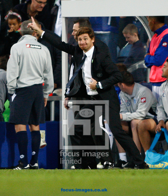 Picture by Andrew Tobin/Focus Images Ltd. 07710 761829. 23/10/11. Andre Villas Boas, manager of Chelsea urges his players forwards during the Barclays Premier League match between QPR and Chelsea at Loftus Road, London.