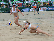 STARE JABLONKI POLAND - July 1:  Nadine Zumkehr /1/ and Joana Heidrich /2/ of Switzerland in action during Day 1 of the FIVB Beach Volleyball World Championships on July 1, 2013 in Stare Jablonki Poland.  (Photo by Piotr Hawalej)
