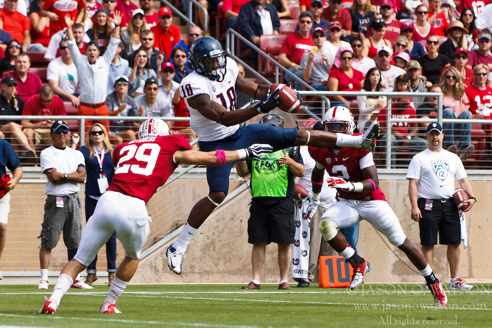 PALO ALTO, CA - OCTOBER 06: Tight end Terrence Miller #18 of the Arizona Wildcats is unable to control a catch after being hit by safety Ed Reynolds #29 of the Stanford Cardinal during the second quarter at Stanford Stadium on October 6, 2012 in Palo Alto, California. The Stanford Cardinal defeated the Arizona Wildcats 54-48 in overtime. (Photo by Jason O. Watson/Getty Images) *** Local Caption *** Terrence Miller; Ed Reynolds