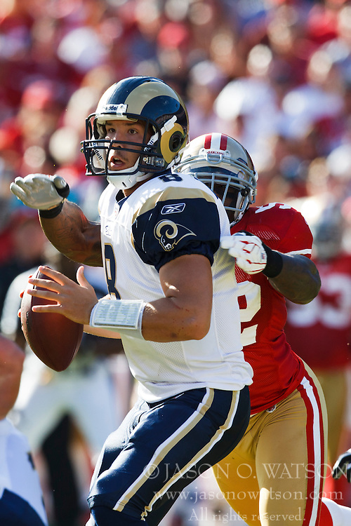 November 14, 2010; San Francisco, CA, USA;  St. Louis Rams quarterback Sam Bradford (8) is hit from behind by San Francisco 49ers linebacker Patrick Willis (52) during the first quarter at Candlestick Park. San Francisco defeated St. Louis 23-20 in overtime.