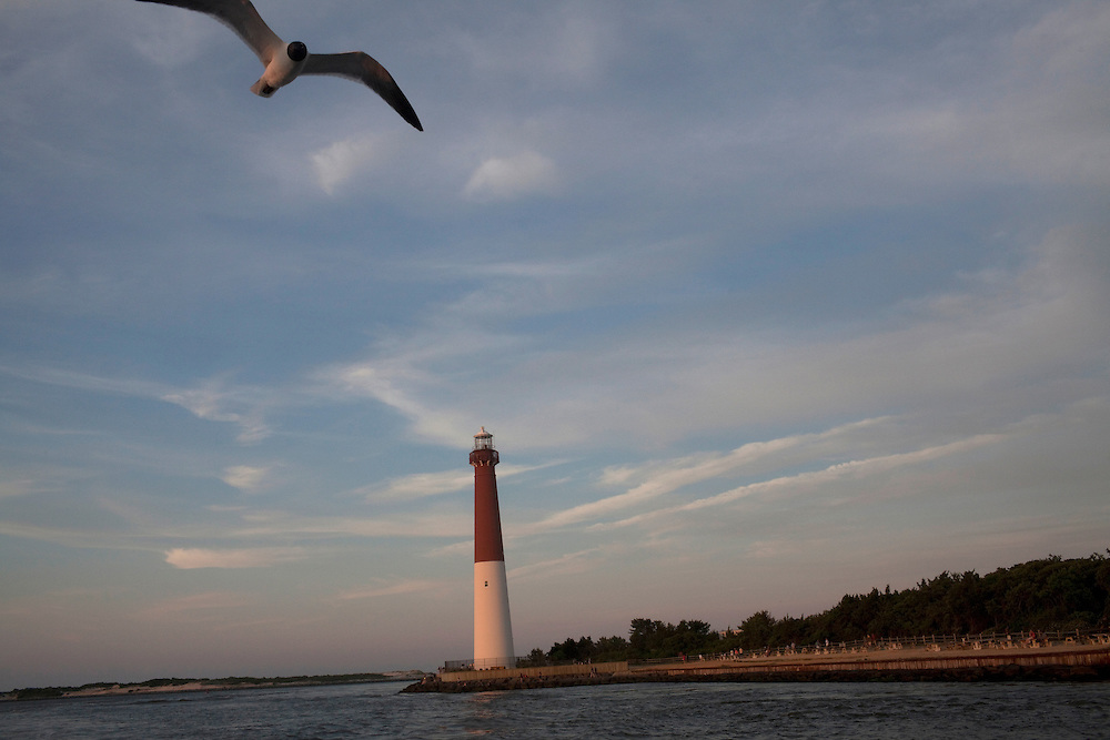 Long Beach Island, NJ - June 29, 2013 :  The Barnegat Lighthouse, built in 1857, on the northern tip of Long Beach Island, NJ on June 29, 2013. People are returning to the beaches for the summer after recovery efforts post Superstorm Sandy.