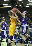 December 30, 2011: Northwestern Wildcats forward Kendall Hackney (4) blocks a shot by Iowa Hawkeyes center Morgan Johnson (12) during the NCAA women's basketball game between the Northwestern Wildcats and the Iowa Hawkeyes at Carver-Hawkeye Arena in Iowa City, Iowa on Wednesday, December 30, 2011.