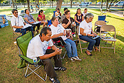18 JUNE 2012 - PHOENIX, AZ:  About 20 people, members of the immigrant rights' group Promise AZ (PAZ) held a prayer vigil at the Arizona State Capitol in Phoenix Monday praying that the US Supreme Court would overturn SB 1070, Arizona's controversial anti-immigrant law. The court's ruling had been expected Monday, June 18 but the the court said the ruling would not come out until later this month. Members of PAZ said they would continue their vigil until the ruling was issued.   PHOTO BY JACK KURTZ