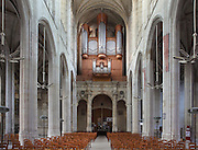 Nave and organ of the Collegiate Church of Saint-Gervais-Saint-Protais, built 12th to 16th centuries in Gothic and Renaissance styles, in Gisors, Eure, Haute-Normandie, France. The church was consecrated in 1119 by Calixtus II but the nave was rebuilt from 1160 after a fire. The church is 70m long and the nave is 24m high with a rib-vaulted ceiling. The organ was built in 1580 by Nicolas Barbier. The church was listed as a historic monument in 1840. Picture by Manuel Cohen