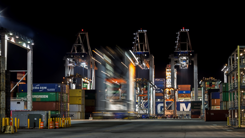 Containers and ship to shore cranes working vessels at the Georgia Ports Authority Garden City Terminal, Thursday, Feb., 15, 2018, in Savannah, Ga.  (GPA Photo/Stephen B. Morton)