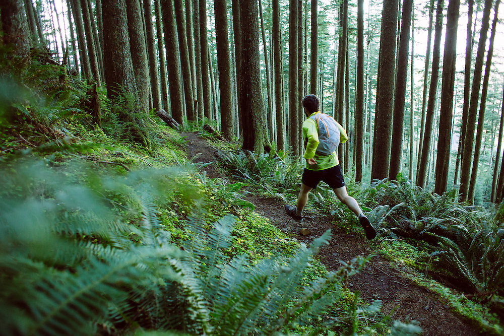 Man trail running the Oregon Coast Trail. Oswald West State Park, OR.