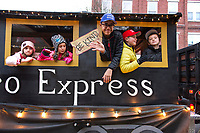 "The ""Cereal Hero Express"" rolls through downtown during the Light Up Laconia Holiday Parade on Sunday afternoon.  (Karen Bobotas/for the Laconia Daily Sun)"