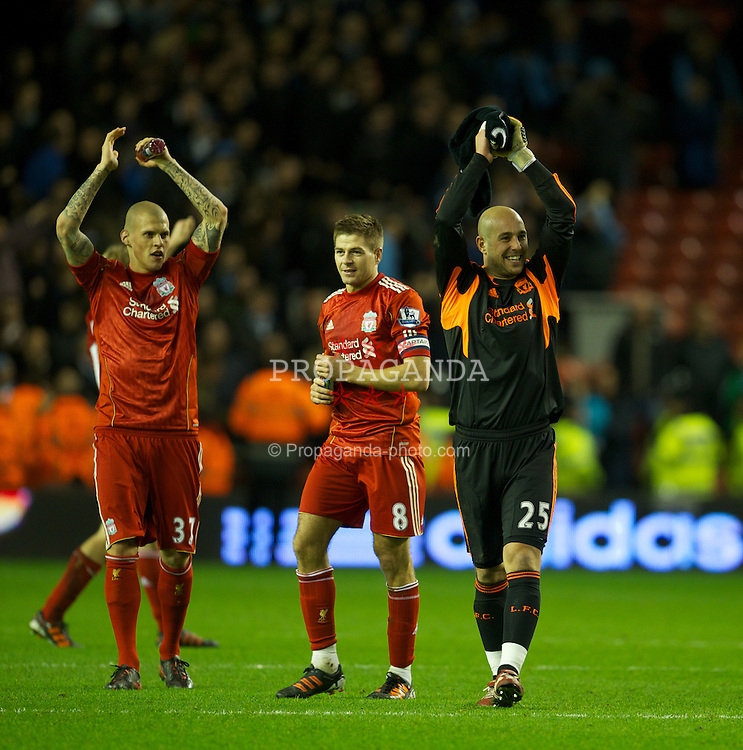 LIVERPOOL, ENGLAND - Wednesday, January 25, 2012: Liverpool's Martin Skrtel, captain Steven Gerrard and goalkeeper Jose Reina celebrate their side's 3-2 aggregate victory over Manchester City during the Football League Cup Semi-Final 2nd Leg at Anfield. (Pic by David Rawcliffe/Propaganda)
