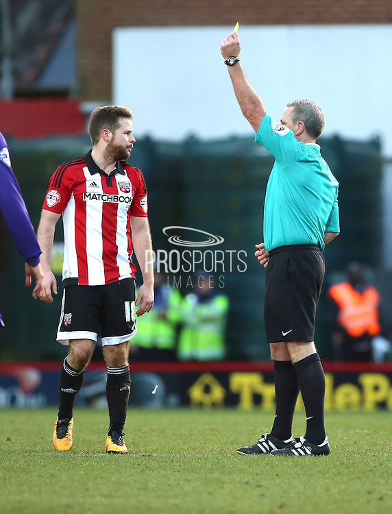 Brentford midfielder, Alan Judge (18) yellow card during the Sky Bet Championship match between Brentford and Charlton Athletic at Griffin Park, London, England on 5 March 2016. Photo by Matthew Redman.