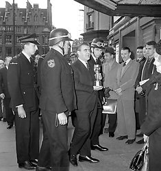 File photo dated 18/3/1966 of flanked by security men, the solid gold Jules Rimet Cup is carried into the National Stamp Exhibition (Stampex) at the Central Hall, Westminster, by Eric Allen, Sales Manager of Stanley Gibbons, the stamp dealers, on whose stand it is being shown. A London gangster and his brother were behind the notorious unsolved theft of the World Cup trophy just months before the 1966 tournament in England, it has been claimed.