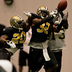 12 August 2009: Cornerback Jabari Greer (32) and cornerback Randall Gay (20) break up a pass intended for wide receiver Rod Harper (13) during New Orleans Saints training camp at the team's indoor practice facility in Metairie, Louisiana.