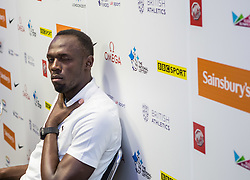 © Licensed to London News Pictures. 23/07/2015. London, UK. Usain Bolt winks at the camera during a press conference in London ahead of his Sainsbury's Anniversary Games appearances tomorrow, at the Queen Elizabeth Olympic Park. Photo credit : James Gourley/LNP