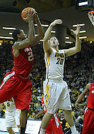 January 04 2010: Ohio State Buckeyes guard/forward David Lighty (23) pulls in a rebound as Iowa Hawkeyes forward Andrew Brommer (20) defends during the second half of an NCAA college basketball game at Carver-Hawkeye Arena in Iowa City, Iowa on January 04, 2010. Ohio State defeated Iowa 73-68.