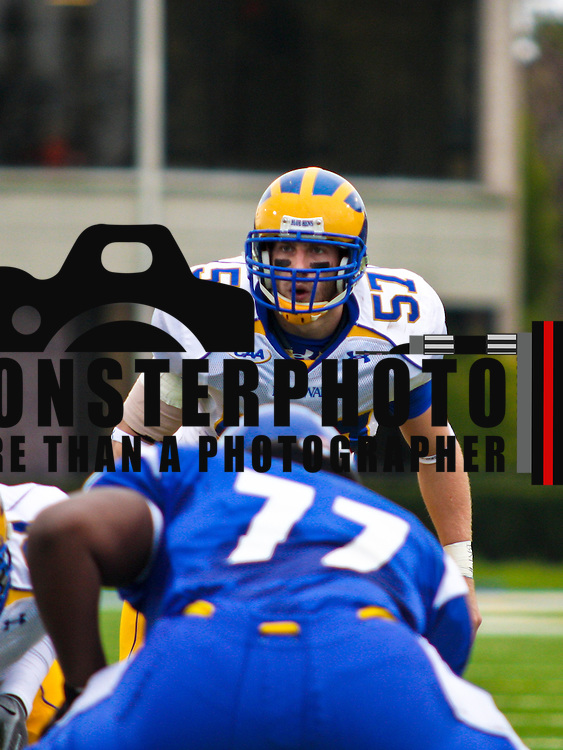 10/25/08 HEMPSTEAD, N.Y.  The University of Delaware pulled out all the stops in attempts to snap a three-game losing streak Saturday at Hofstra. It worked. With a pair of All-American receivers and in Robbie Agnone and Aaron Love sharing the quarterback duties, senior Junior Jabbie (above) piling up 155 yards rushing, and an active defense holding Hofstra to just 179 total yards, the Blue Hens posted a 17-0 Colonial Athletic Association football victory at rainy Shuart Stadium.