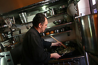 Chef Gilles Dupart, the co-owner of Oh! Lá Lá, cooking in his kitchen at the small yet very popular restaurant in Cartagena, on Saturday, August 23, 2008. (Photo/Scott Dalton)