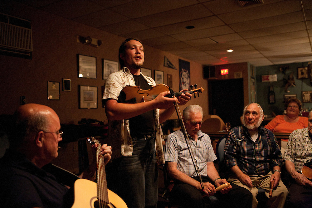 Fiddler Daniel Boucher leads a group of French-Canadian musicians as they gather for an evening of Quebecois music at a restaurant in Burlington, Connecticut.