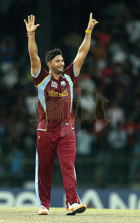 Ravi Rampaul of The West Indies celebrates the final wicket and the win during the ICC World Twenty20 semi final match between Australia and The West Indies held at the Premadasa Stadium in Colombo, Sri Lanka on the 5th October 2012..Photo by Ron Gaunt/SPORTZPICS