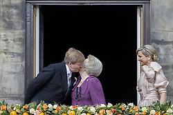 59584680  .Dutch King Willem-Alexander (L) kisses his mother, Ex-Queen Beatrix on the balcony of the Royal Palace in Amsterdam, on April 30, 2013. After 33 years on the throne, Dutch Queen Beatrix abdicated in favor of her son Willem-Alexander on Tuesday 30, April 2013. Photo by: i-Images.UK ONLY