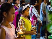 27 MARCH 2016 - BANGKOK, THAILAND:  Girls with lanterns lead a procession into Santa Cruz Church in Bangkok on Easter Sunday. Santa Cruz was one of the first Catholic churches established in Bangkok. It was built in the late 1700s by Portuguese soldiers allied with King Taksin the Great in his battles against the Burmese who invaded Thailand (then Siam). There are about 300,000 Catholics in Thailand, in 10 dioceses with 436 parishes. Easter marks the resurrection of Jesus after his crucifixion and is celebrated in Christian communities around the world.     PHOTO BY JACK KURTZ