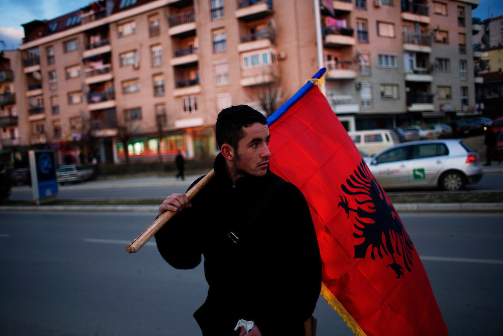 One of hundreds of venders selling Kosovo memorabilia to local Kosovars to celebrate the anniversary. The main item were Albanian, American and Kosova flags...Prishtina, Kosovo - Eve of one-year anniverary - February 16, 2009.