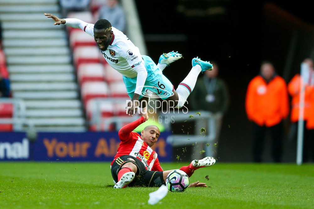Sunderland midfielder Wahbi Khazri (10) fouls West Ham United Midfielder Domingos Quina (36)  during the Premier League match between Sunderland and West Ham United at the Stadium Of Light, Sunderland, England on 15 April 2017. Photo by Simon Davies.