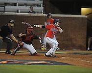 Mississippi's Tanner Mathis (12) hits an RBI triple vs. St. John's during an NCAA Regional at Davenport Field in Charlottesville, Va. on Friday, June 4, 2010.