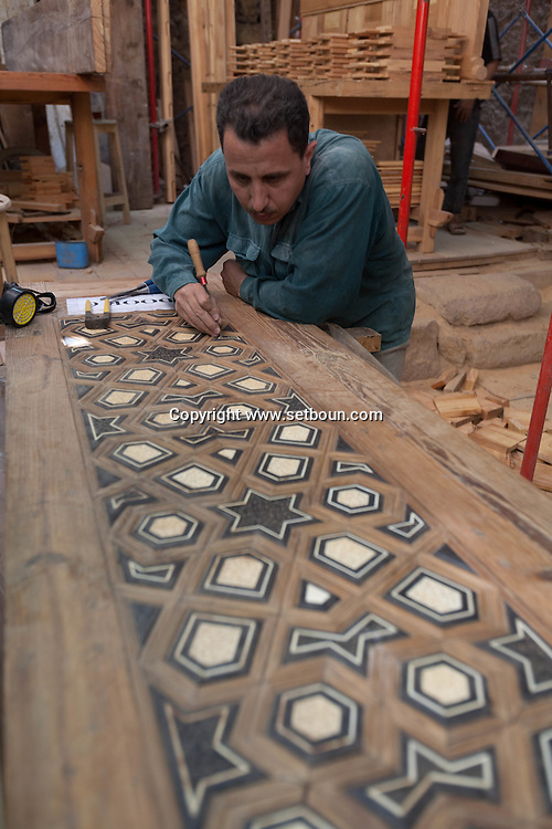 Egypt. Cairo -WORKSHOP . Mosque mausoleum of KAYRBAK , NM248 , under renovation by the Agha Khan fondation in Darb al Ahmar street, restoration  workshop, for the inhabitants  of this poor area , islamic Cairo +
