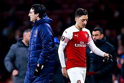 Mesut Ozil of Arsenal walks past Arsenal manager Unai Emery - Mandatory by-line: Robbie Stephenson/JMP - 13/12/2018 - FOOTBALL - Emirates Stadium - London, England - Arsenal v Qarabag - UEFA Europa League group stage