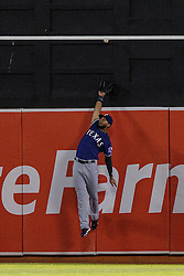 OAKLAND, CA - JUNE 14:  Nomar Mazara #30 of the Texas Rangers leaps for but is unable to catch a fly ball hit off the bat of Josh Phegley (not pictured) of the Oakland Athletics for an RBI double during the sixth inning at the Oakland Coliseum on June 14, 2016 in Oakland, California. (Photo by Jason O. Watson/Getty Images) *** Local Caption *** Nomar Mazara